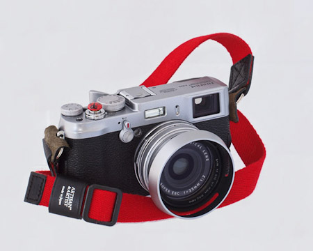 Fuji X100 with standard issue Red ACAM-103 Strap and Red bug