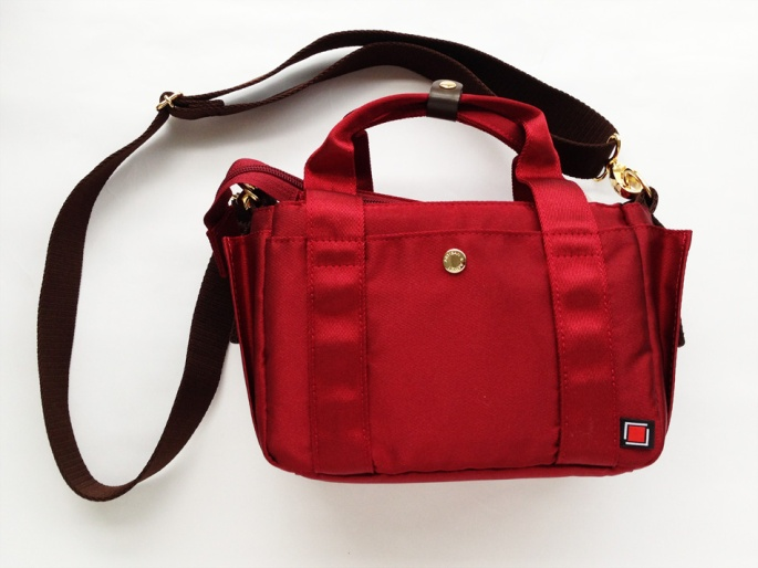 A lovely small red camera bag suitable for Micro Four Thirds mount cameras.